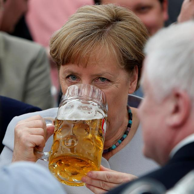 <p>German Chancellor and head of the Christian Democratic Union (CDU) Angela Merkel drinks during the Trudering festival in Munich, Germany, May 28, 2017. (Photo: Michaela Rehle/Reuters) </p>