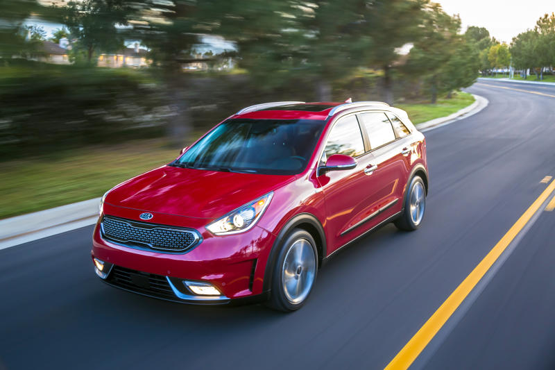 This undated photo provided by Kia shows the 2019 Kia Niro, a hybrid compact SUV with an EPA-estimated 50 mpg in mixed driving. (Bruce Benedict/Kia Motors America via AP)