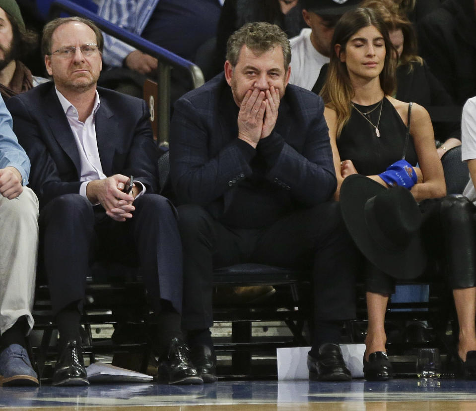 FILE - In this March 17, 2015, file photo, Madison Square Garden Chairman James Dolan, center, watches during the first half of an NBA basketball game against the San Antonio Spurs, in New York. Carmelo Anthony says the decision to issue an apology for his interaction with a fan was made by Madison Square Garden chairman James Dolan. Anthony told a heckling fan Tuesday, March 1, 2016, during the Knicks' loss to Portland to ask Dolan for his money back, pointing to the owner sitting nearby.  (AP Photo/Frank Franklin II)