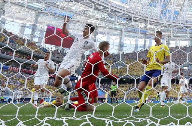 Soccer Football - World Cup - Group F - Sweden vs South Korea - Nizhny Novgorod Stadium, Nizhny Novgorod, Russia - June 18, 2018 Sweden's Robin Olsen and South Korea's Son Heung-min in action REUTERS/Ivan Alvarado