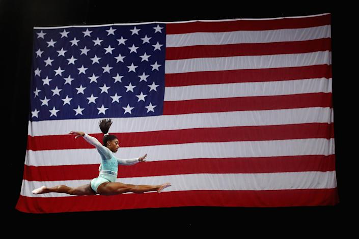 Simone Biles wore a teal leotard in solidarity of victims of sexual abuse [Photo: Getty]