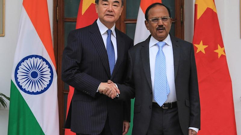 China, India vow to work on border issues as violence erupts in Kashmir
