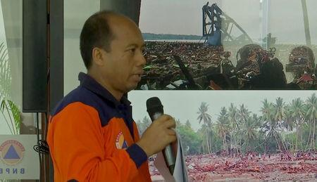 Sutopo Purwo Nugroho, a spokesman of Indonesia's Mitigation and Disaster Agency (BNPB), holds a second news conference, to brief on the latest situation after a strong quake and tsunami hit at Sulawesi island, killing at least dozens of people on Friday, September 29, 2018. REUTERS/Reuters TV