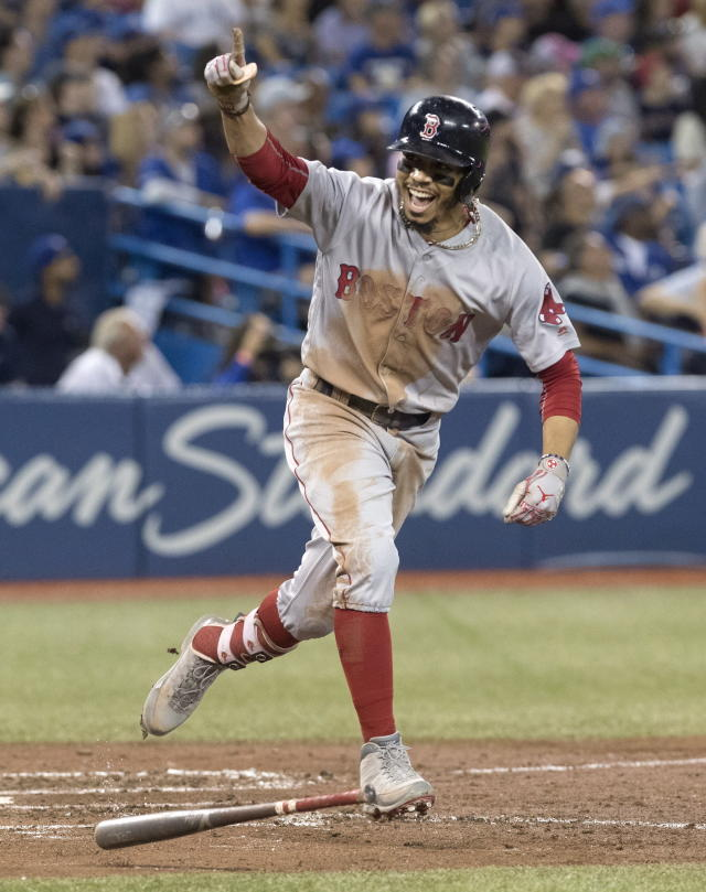 Boston Red Sox's Mookie Betts celebrates after hitting a home run during the ninth inning against the Toronto Blue Jays in a baseball game Thursday, Aug. 9, 2018, in Toronto. (Fred Thornhill/The Canadian Press via AP)