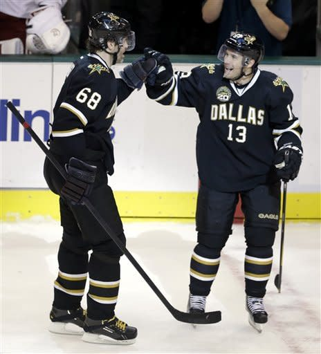 Dallas Stars' Jaromir Jagr (68), of the Czech Republic, is congratulated by teammate Ray Whitney (13) following his shootout goal against Phoenix Coyotes goalie Mike Smith in an NHL hockey game on Friday, Feb. 1, 2013, in Dallas. The goal gave the Stars a 4-3 win. (AP Photo/Tony Gutierrez)