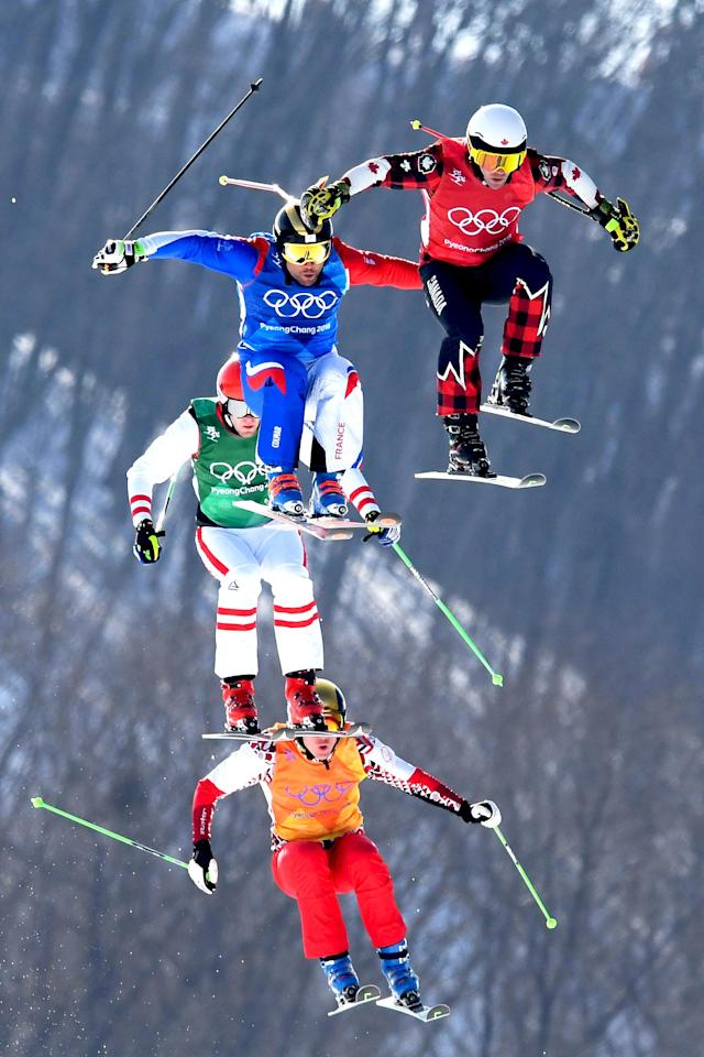 <p>Canada's Kevin Drury, France's Arnaud Bovolenta, OAR's Semem Denishchikov, and Austria's Robert Winkler compete in the Freestyle Skiing Men's Ski Cross Quarterfinals on day 12 of the PyeongChang 2018 Winter Olympic Games in Pyeongchang, South Korea, February 21, 2018.<br> (Photo by Quinn Rooney/Getty Images) </p>
