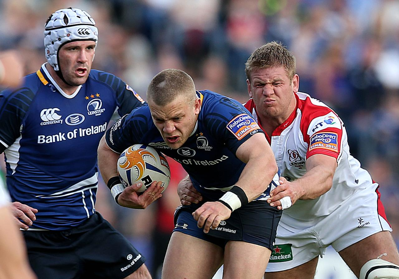 Leinster's Ian Madigan evades a tackle from Ulster's Chris Henry during the RaboDirect PRO12 Final at the RDS, Dublin, Ireland.