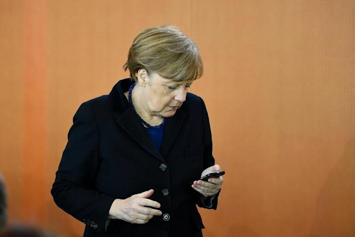 The BND spy scandal has damaged Chancellor Angela Merkel's credibility with German voters, according to the latest opinion polls (AFP Photo/Tobias Schwarz)