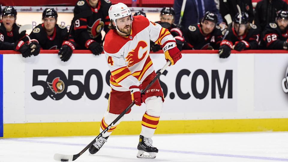 OTTAWA, ON - MARCH 22: Calgary Flames Defenceman Rasmus Andersson (4) controls the puck during the third period of the NHL game between the Ottawa Senators and the Calgary Flames on March 22, 2021 at the Canadian Tire Centre in Ottawa, Ontario, Canada. (Photo by Steven Kingsman/Icon Sportswire via Getty Images)
