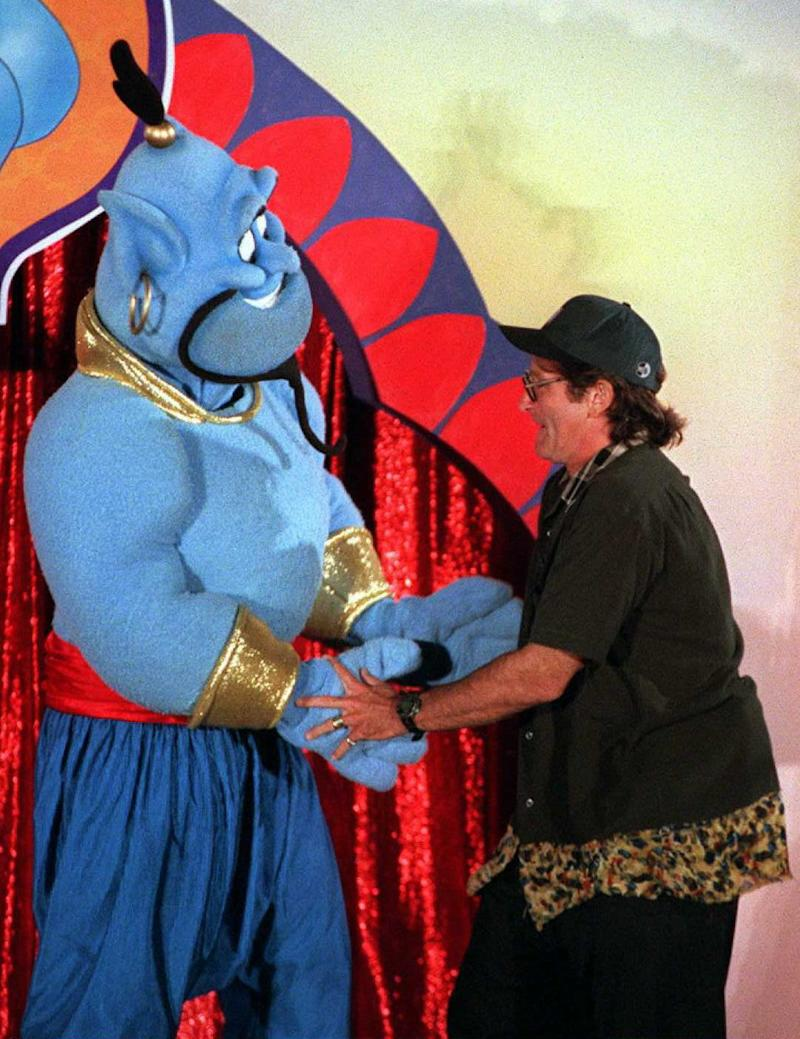 LOS ANGELES, CA - JULY 10: Actor-comedian Robin Williams dances 10 July in Los Angeles with the Disney character 'Genie' during a celebration for the scheduled 13 August world release of the film 'Aladdin and the King of Thieves'. Williams who plays the voice of 'Genie' in the third sequel to the Aladdin trilogy entertained an audience of 5,000. The movie will be the first in the trilogy to be released direct to the home video market instead of in the movie theaters. AFP PHOTO John T. BARR/mn (Photo credit should read JOHN T. BARR/AFP/Getty Images)