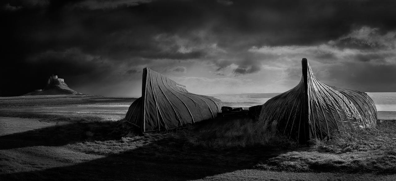 """Lindisfarne, Northumberland: David Byrne's said his captivating image, which was the overall winner, was taken because """"I love monochrome landscapes and Britain has some of the best landscapes you can find"""". Mr Byrne, from Staffordshire, won the overall title and £10,000 for his efforts. (David Byrne, Landscape Photographer of the Year)"""