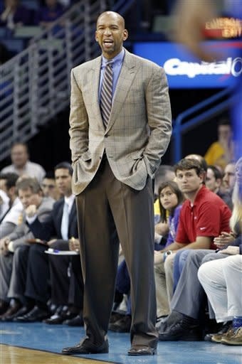 New Orleans Hornets head coach Monty Williams calls out to his team in the first half of an NBA basketball game against the Golden sTate Warriors in New Orleans, Wednesday, March 21, 2012. (AP Photo/Gerald Herbert)