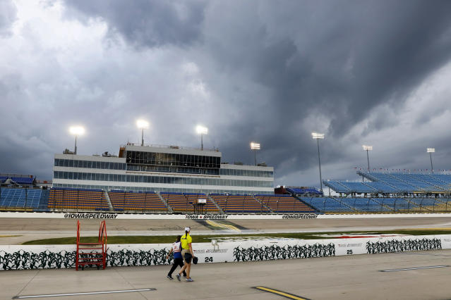 Storms clouds roll in over the grandstands before the IndyCar Series auto race Saturday, July 20, 2019, at Iowa Speedway in Newton, Iowa. (AP Photo/Charlie Neibergall)