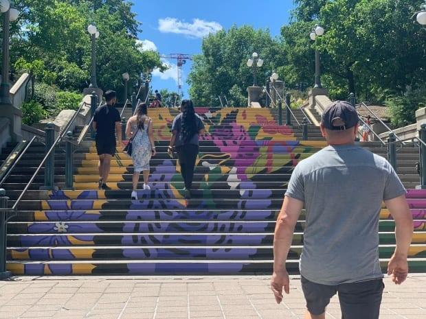 People climb the stairs up to Major's Hill Park from the ByWard Market in Ottawa on Sunday.  (Joseph Tunney/CBC  - image credit)