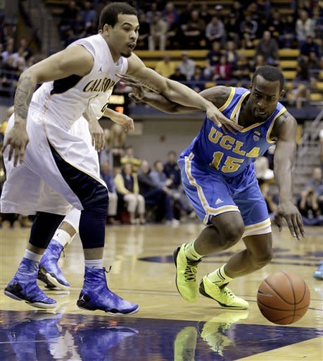 UCLA's Shabazz Muhammad (15) and California's Justin Cobbs chase a loose ball during the first half of an NCAA college basketball game, Thursday, Feb. 14, 2013, in Berkeley, Calif. (AP Photo/Ben Margot)