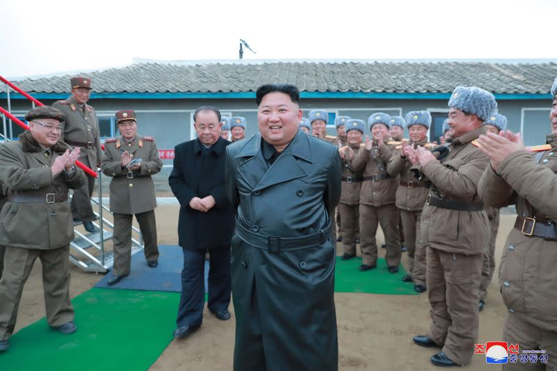 North Korean leader Kim Jong Un oversees rocket system test in this undated picture released by KCNA