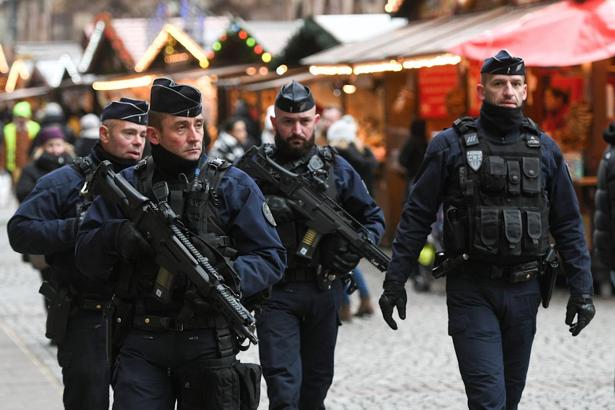 French policemen patrol during the reopening of the Christmas market of Strasbourg, eastern France, on Dec.14, 2018 as the author of the attack was killed on Dec. 13, 2018. The Chrismas market closed as three people were killed and 13 wounded when a lone gunman, identified as Cherif Chekatt, 29, opened fire on shoppers on Dec. 11, 2018. (Photo: Sebastien Bozon/AFP/Getty Images)