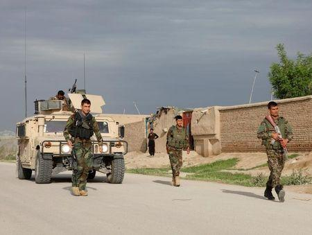 Taliban kill at least 140 in base attack