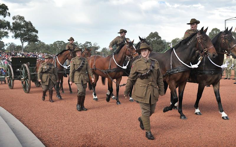 Servicemen and women wear period uniforms to mark the centenary of the Gallipoli landings on Anzac Day in Canberra in 2015. - Credit: MARK GRAHAM/AFP/Getty Images