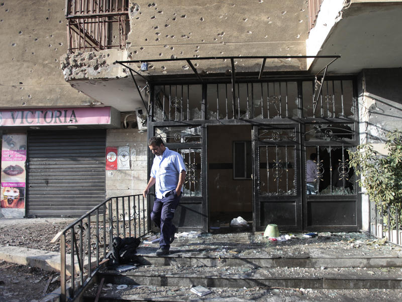 A Lebanese man steps out from a destroyed building that was damaged during clashes erupted between pro- and anti-Syrian Sunni groups, in Beirut, Lebanon, Monday May 21, 2012. Gunmen fired rocket-propelled grenades and machine guns early Monday in intense street battles in the Lebanese capital, wounding and killed several people as fears mounted that the conflict in neighboring Syria was bleeding across the border. The clashes erupted hours after an anti-Syrian cleric and his bodyguard were shot dead in northern Lebanon.(AP Photo/Hussein Malla)