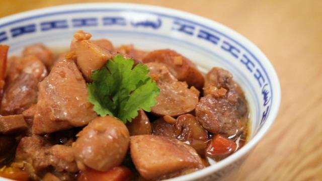 Braised chicken and button mushrooms in a blue Chinese porcelain bowl