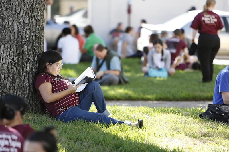 Texas A&M advisor Maria Blando waits for the campus to reopen while authorities investigate a bomb threat Friday, Oct. 19, 2012 in College Station, Texas. (AP Photo/Jon Eilts)