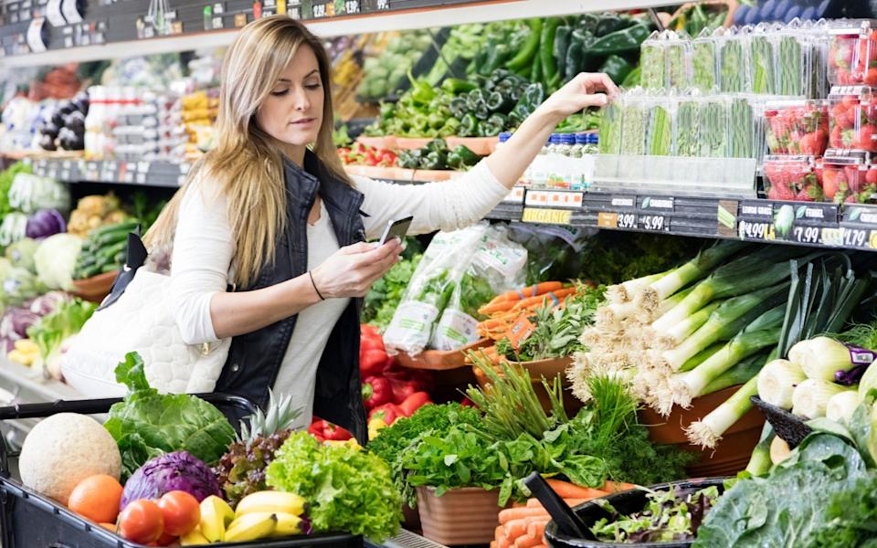Woman shopping for vegetables