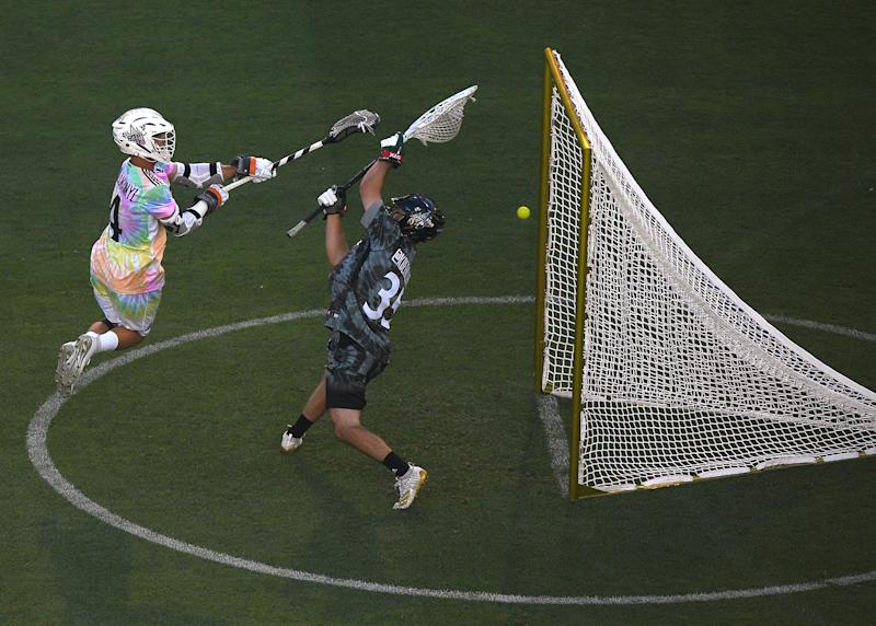 LOS ANGELES, CALIFORNIA - JULY 21: Will Manny #4 of Team Baptiste scores a goal past Kyle Berniohr #35 of Team Rambo, for a 6-6 tie, during the Premier Lacrosse League all star game between Team Baptiste and Team Rambo at Banc of California Stadium on July 21, 2019 in Los Angeles, California. (Photo by Harry How/Getty Images)