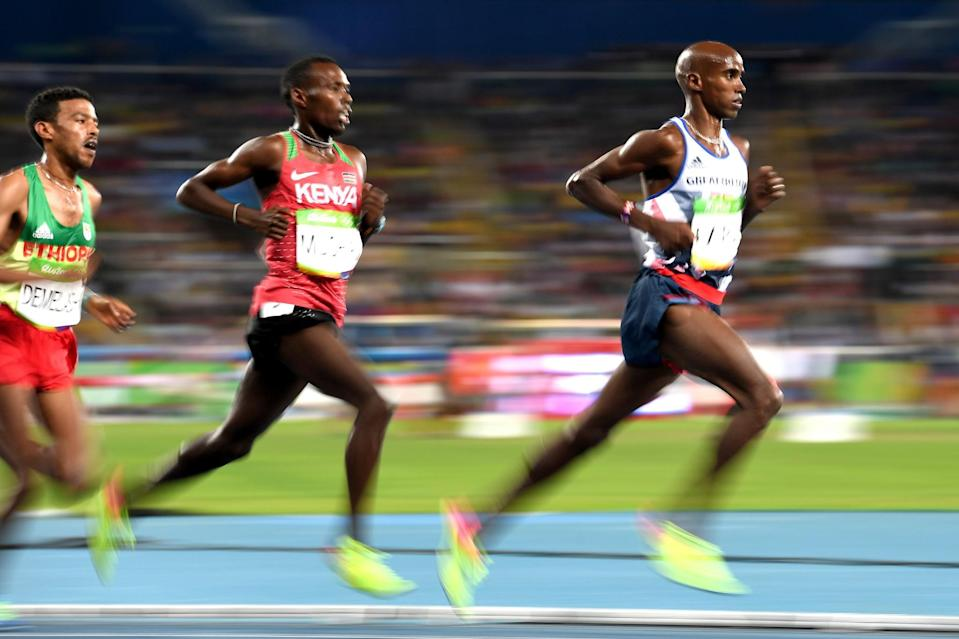 <p>Bedan Karoki Muchiri of Kenya and Mohamed Farah (R) of Great Britain competes during the Men's 10,000m on Day 8 of the Rio 2016 Olympic Games at the Olympic Stadium on August 13, 2016 in Rio de Janeiro, Brazil. (Photo by Shaun Botterill/Getty Images) </p>