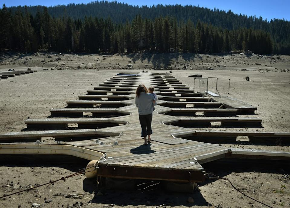 "<div class=""inline-image__caption""><p>Marina owner Mitzi Richards carries her granddaughter as they walk on their boat dock at the dried up lake bed of Huntington Lake which is at only 30 percent capacity as a severe drought continues to affect California on September 23, 2014. California is in the grip of its third year of severe drought, the worst in decades, threatening to drain underground aquifers and leaving the taps of some 40 million people to run dry. The state's drought affected Central Valley, is the considered the richest food-producing region in the world, where much of America's fresh fruits, nuts and vegetables being grown there</p></div> <div class=""inline-image__credit"">Mark Ralston/Getty</div>"