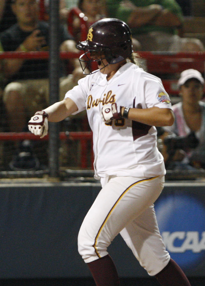 Arizona State's Mandy Urfer (36) celebrates on her way to home plate after hitting a home run against Florida in the fourth inning during the Women's College World Series softball championship at ASA Hall of Fame Stadium in Oklahoma City, Friday, June 3, 2011. (AP Photo/Alonzo Adams)