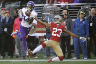 Minnesota Vikings wide receiver Stefon Diggs (14) catches a touchdown pass in front of San Francisco 49ers cornerback Ahkello Witherspoon (23) during the first half of an NFL divisional playoff football game, Saturday, Jan. 11, 2020, in Santa Clara, Calif. (AP Photo/Marcio Jose Sanchez)
