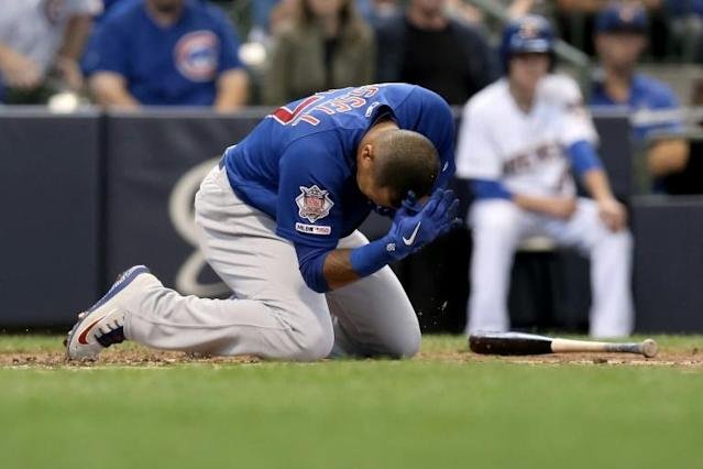 Chicago Cubs shortstop Addison Russell reacts after being hit by a pitch in a Major League Baseball loss to the Milwaukee Brewers (AFP Photo/Dylan Buell)