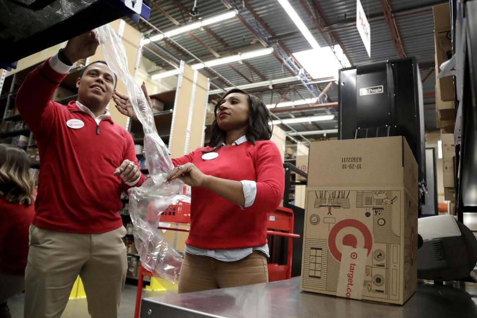 <p> FILE - In this Nov. 16, 2018, file photo, employees demonstrate how air pillow machines work at a packaging station in the backroom of a Target store in Edison, N.J. For many retailers that have lifted pay to attract and keep workers, another challenge has arisen: Making those workers productive enough to justify the larger payouts. (AP Photo/Julio Cortez, File) </p>