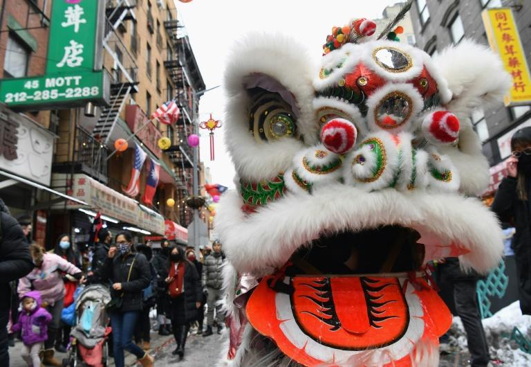 People celebrate the Lunar New Year holiday in Chinatown on February 12, 2021 in New York City