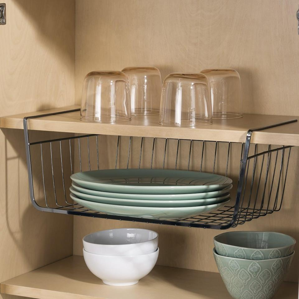 <p>From snacks to kitchen tools and more, the <span> Under Shelf Basket</span> ($13, originally $20) will let you make use of the space underneath your cabinet shelves.</p>