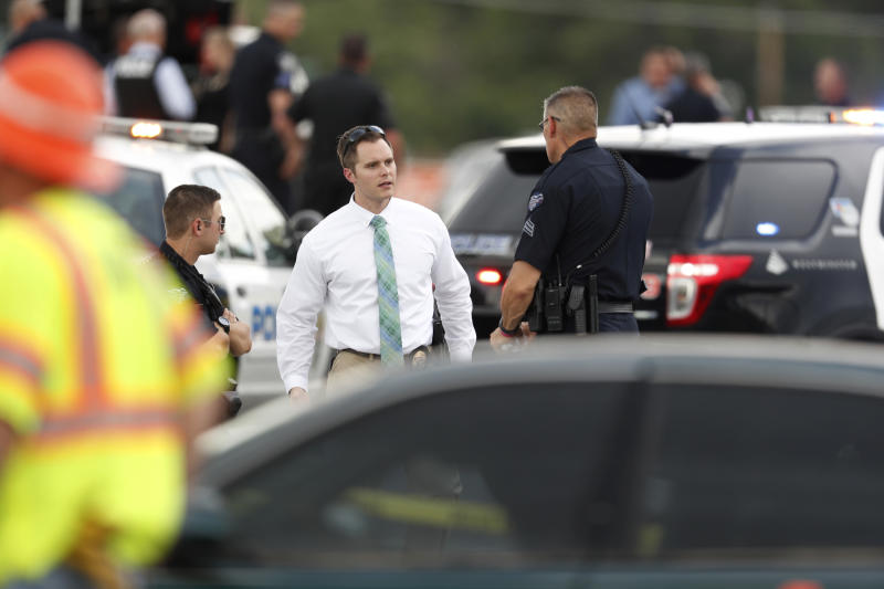 Law enforcement officials investigate the scene of a shooting in a parking lot behind a dentist's office, Thursday, June 14, 2018, in Westminster, Colo. (AP Photo/David Zalubowski)