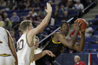 East Carolina center Charles Coleman, right, moves toward the basket as Navy center Evan Wieck defends during the first half of an NCAA college basketball game at the Veterans Classic Tournament, Friday, Nov. 8, 2019, in Annapolis, Md. (AP Photo/Julio Cortez)