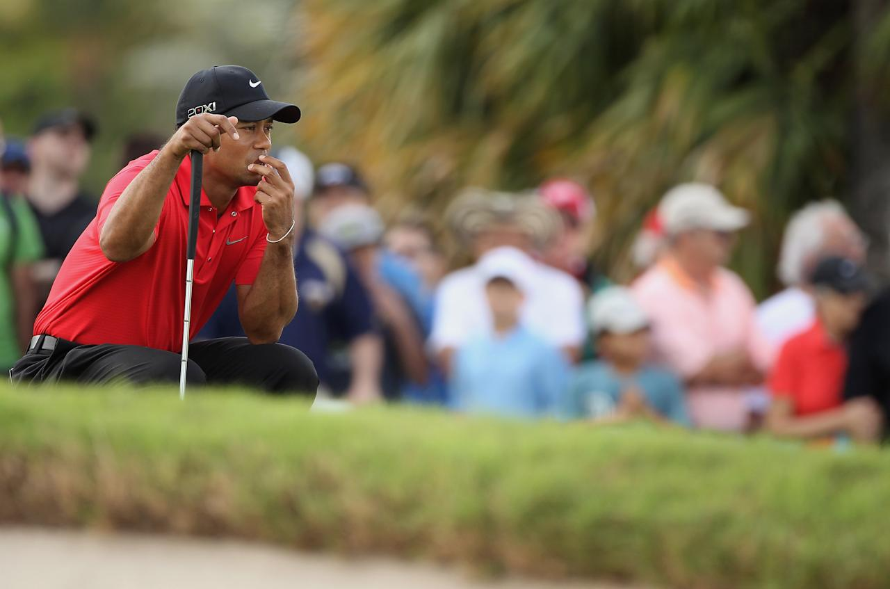 MIAMI, FL - MARCH 11:  Tiger Woods waits on the fourth green during the final round of the World Golf Championships-Cadillac Championship on the TPC Blue Monster at Doral Golf Resort And Spa on March 11, 2012 in Miami, Florida.  (Photo by Scott Halleran/Getty Images)