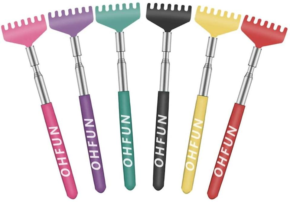 """<h3>Extendable Back Scratcher Set</h3><br>Help them scratch their own backs with this Amazon's Choice six-pack of extendable scratchers with soft rubber handles in an array of festive hues. <br><br><strong>OHFUN</strong> Extendable Back Scratches (6-Pack), $, available at <a href=""""https://amzn.to/3lyHhcw"""" rel=""""nofollow noopener"""" target=""""_blank"""" data-ylk=""""slk:Amazon"""" class=""""link rapid-noclick-resp"""">Amazon</a>"""