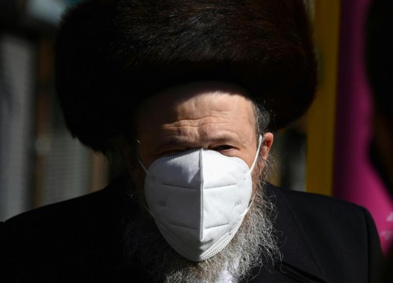 A Hasidic Jewish man wears a N-95 face mask in the Borough Park section of Brooklyn, New York on October 9, 2020