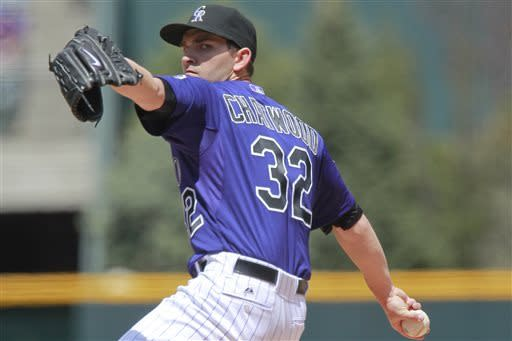 Colorado Rockies starting pitcher Tyler Chatwood throws against Atlanta Braves' B.J. Upton (2) during the first inning of a baseball game on Wednesday, April 24, 2013, in Denver. (AP Photo/Barry Gutierrez)