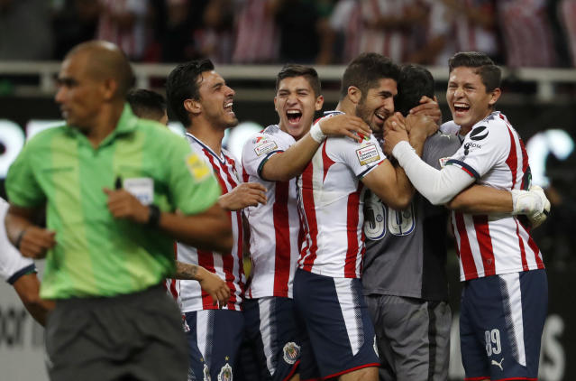 Chivas players celebrate their victory over Toronto FC after a penalty shoot out, at the end of the CONCACAF Champions League final soccer match in Guadalajara, Mexico, Wednesday, April, 25, 2018. (AP Photo/Eduardo Verdugo)