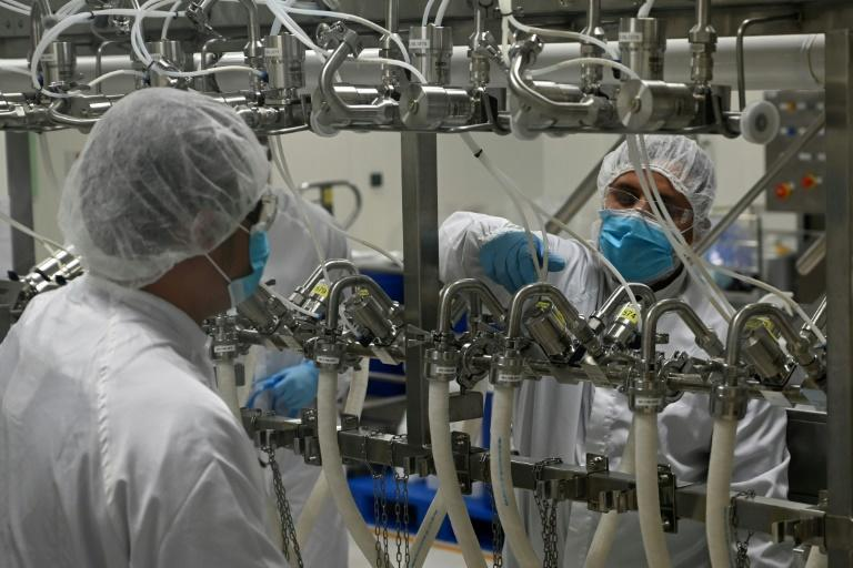 Biochemists work inside a buffer preparation room at Takeda Pharmaceuticals (Asia Pacific) in Singapore. The city-state's coronavirus-hit economy has received a shot in the arm from robust global drug demand
