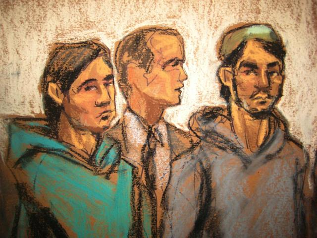 In this courtroom drawing, defendant Akhror Saidakmetov, left, an interpreter, center, and defendant Abdurasul Juraboev appear at federal court in New York on terrorism charges, Feb. 25, 2015. Saidakmetov and Juraboev are two of the three men arrested on charges of plotting to travel to Syria to join the Islamic State group and wage war against the U.S. (Photo of sketch: Jane Rosenberg/AP)