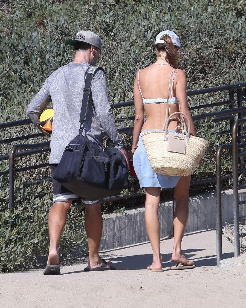 Alessandra Ambrosio and Richard Lee play a game of beach volleyball in Santa Monica, Calif., Sept. 18. - Credit: TheCelebrityfinder/MEGA