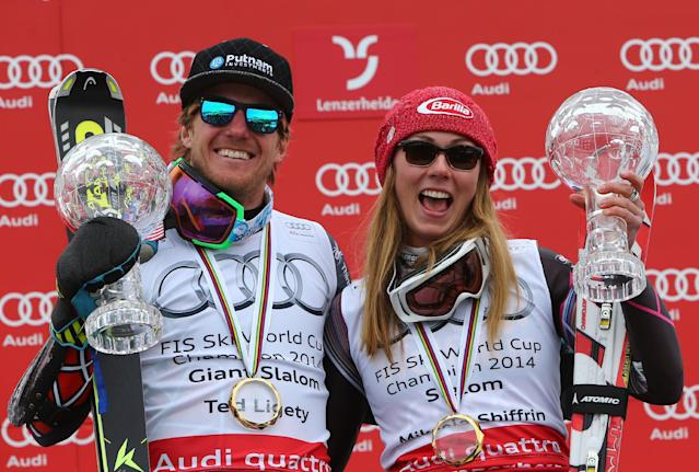 Ted Ligety, of the United States, holds his trophy for an Alpine Ski men's giant slalom, left, as compatriot Mikaela Shiffrin holds her trophy for a women's slalom, at the World Cup finals, in Lenzerheide, Switzerland, Saturday, March 15, 2014. (AP Photo/Armando Trovati)