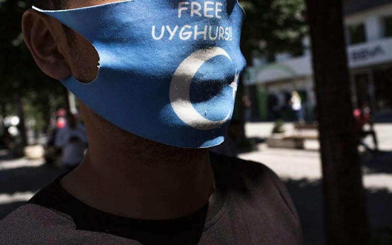 An anti-china activist wears a Free Uighurs mask, in Istanbul, Turkey - Sam Tarling for The Telegraph