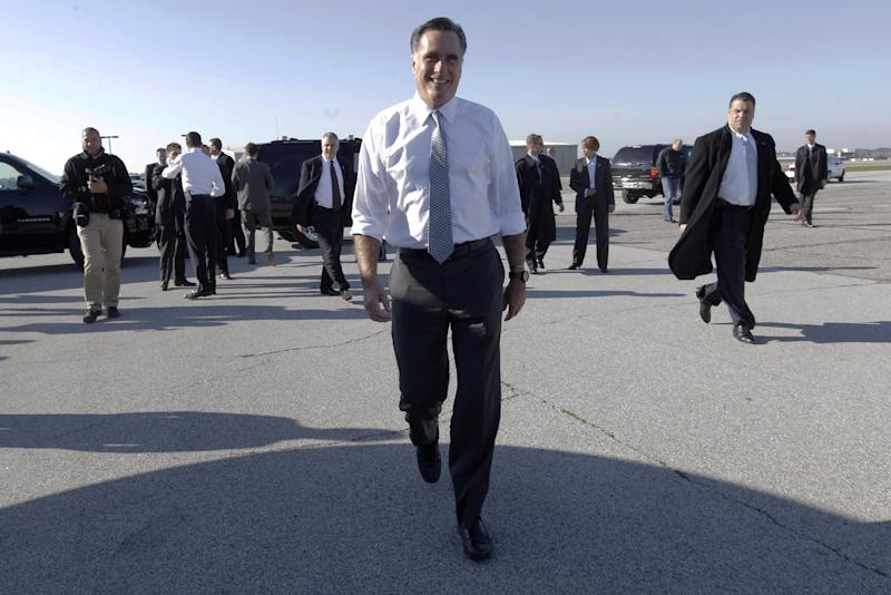 Republican presidential candidate, former Massachusetts Gov. Mitt Romney walks toward members of the press after arriving at Cleveland Hopkins International Airport, Tuesday, Nov. 6, 2012, in Cleveland, Ohio.  (AP Photo/Mary Altaffer)