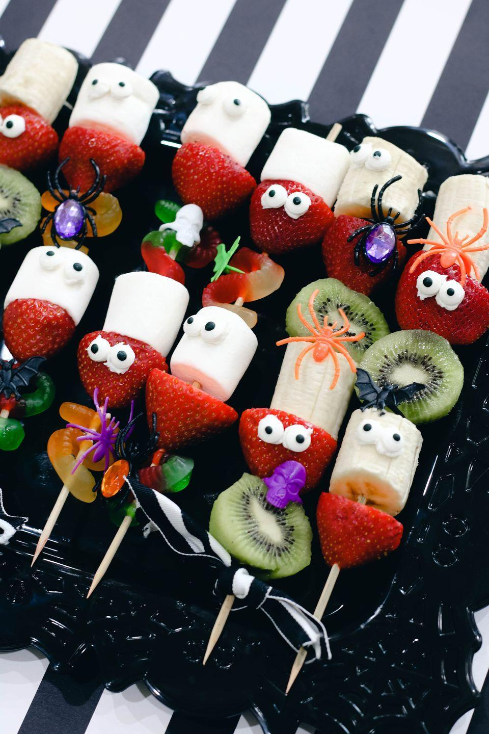 """<p>Fresh fruit and marshmallows are finished off with eyeballs for a fun and easy-to-make treat.</p><p><a class=""""link rapid-noclick-resp"""" href=""""https://www.girllovesglam.com/halloween-skewers-healthy-and-non-healthy-versions/#more-9679"""" rel=""""nofollow noopener"""" target=""""_blank"""" data-ylk=""""slk:GET THE RECIPE"""">GET THE RECIPE</a></p>"""